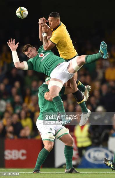 Ireland's Jack McGrath and Australian Wallabies Israel Folau jump for the ball during the third and final rugby union Test match between Ireland and...