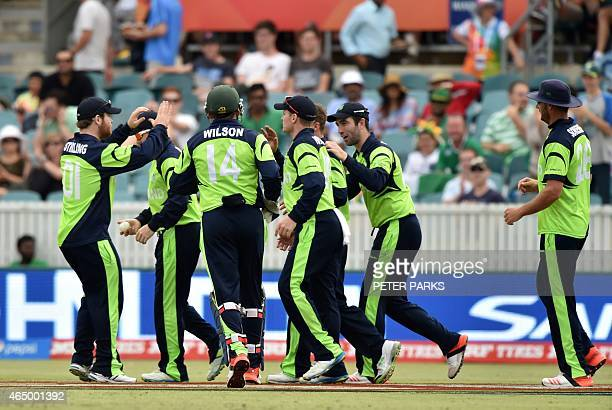 Ireland's players celebrate after dismissing South Africa's AB de Villiers during the 2015 Cricket World Cup Pool B match between Ireland and South...