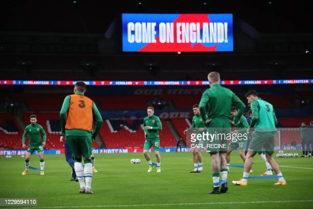 Ireland's players warm up on the pitch ahead of the international friendly football match between England and Republic of Ireland at Wembley stadium...