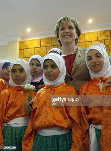 Ireland's President Mary McAleese visits poses with Lebanese Muslim girls during her visit to Irish troops serving with the United Nations Interim...