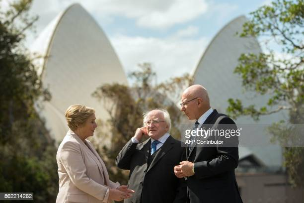 Ireland's President Michael Higgins talks with New South Wales' Governor David Hurley as they walk in the garden with Ireland's Deputy Prime Minister...