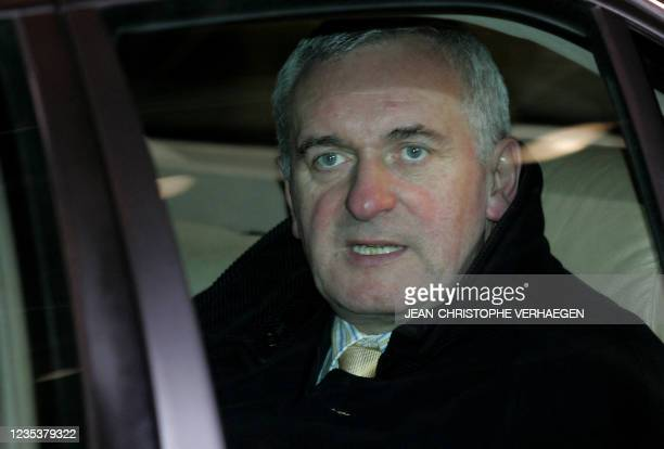 Ireland's Prime Minister Bertie Ahern leaves the EU headquarters after the first day of a European Union summit 14 December 2006, in Brussels....