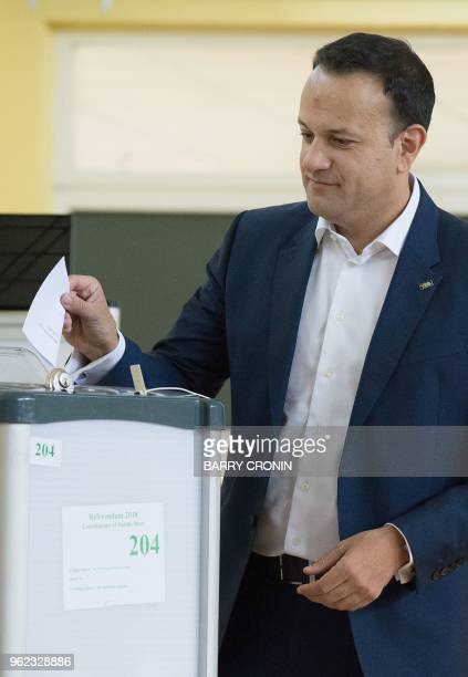 Ireland's Prime Minister Leo Varadakar poses for a photograph as he casts his ballot paper as he votes inside a polling station during the Irish...