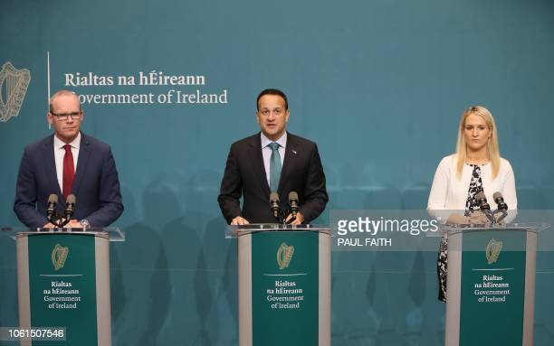 Ireland's Prime Minister Leo Varadkar makes a statement flanked by Ireland's Foreign Minister Simon Coveney and Ireland's Minister of State for...
