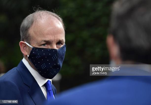 Ireland's Prime Minister Micheal Martin arrives for a European Union Council in Brussels on July 17 as the leaders of the European Union hold their...