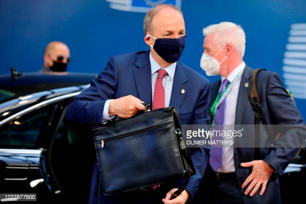 Ireland's Prime Minister Micheal Martin arrives for an EU summit at the European Council building in Brussels, on July 18 as the leaders of the...