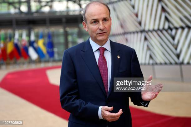 Ireland's Prime Minister Micheal Martin makes a statement as he arrives for an EU summit at the European Council building in Brussels on July 20 as...