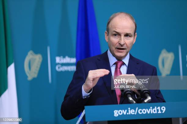 Ireland's Prime Minister Micheal Martin speaks during a press confernce after addressing the Irish nation at Government Buildings in Dublin on...