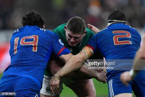 TOPSHOT Ireland's prop Tadhg Furlong vies with France's Paul Gabrillagues and France's hooker Guilhem Guirado during the Six Nations rugby union...