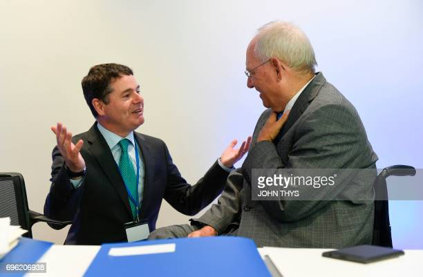 Ireland's Public Expenditure and Reform Minister Paschal Donohoe talks with German Finance Minister Wolfgang Schaeuble during an European Mechanism...