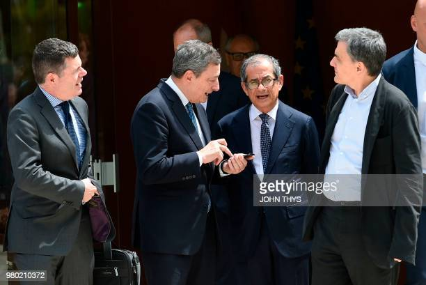 Ireland's Public Expenditure and Reform Minister Paschal Donohoe talks with Greek Finance Minister Euclid Tsakalotos President of the European...