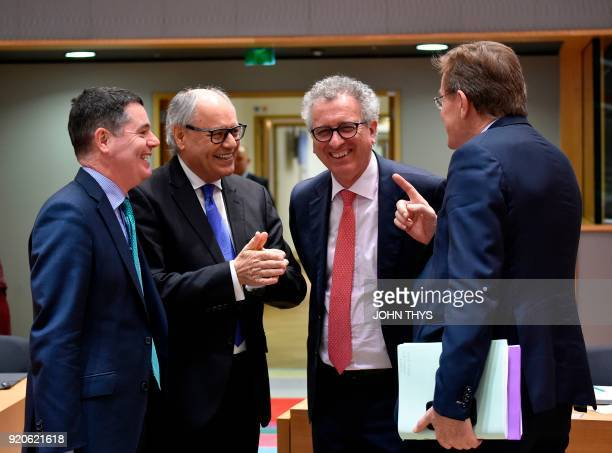Ireland's Public Expenditure and Reform MinisterPaschal Donohoe speaks with Maltese Finance minister Edward Scicluna Luxembourg's Finance Minister...