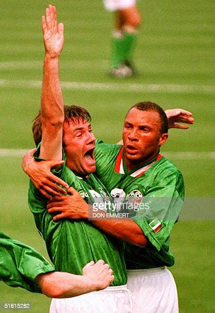 Ireland's Ray Houghton is congratulated by teammate Terry Phelan after Houghton scored a goal against Italy during their World Cup match at Giants...