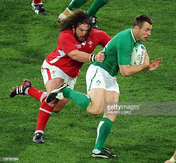 Ireland's right wing Tommy Bowe is tackled by Wales' prop Adam Jones during the 2011 Rugby World Cup quarter-final match Ireland vs Wales at the...