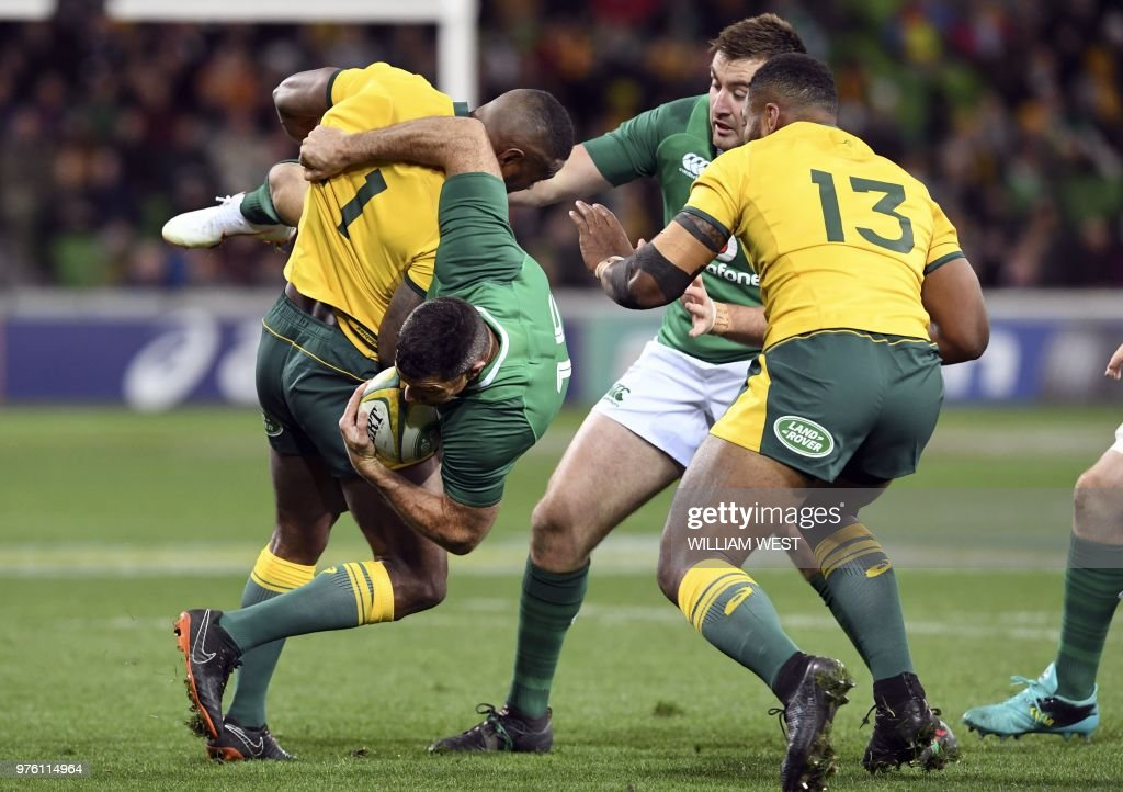 Ireland's Rob Kearney (2nd L) is tackled by Australian Wallabies winger Marika Koroibete (L) during the second rugby union Test match between Ireland and Australia in Melbourne on June 16, 2018. (Photo by WILLIAM WEST / AFP) / --IMAGE