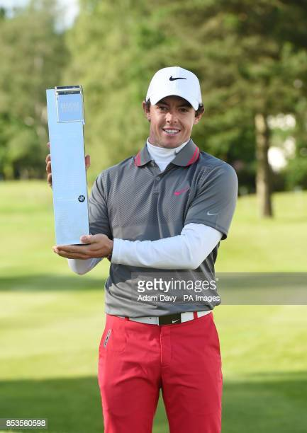 Ireland's Rory McIlroy celebrates with the trophy after winning the BMW PGA Championships at the Wentworth Club Surrey