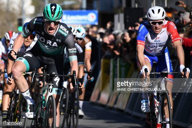 Ireland's Sam Bennett celebrates as he crosses the finish line ahead of France's Arnaud Demare at the end of the 1765km 6th stage of the 77th...