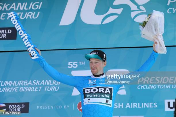 """Ireland's Sam Bennett, riding for the Bora-Hansgrohe team, earns the """"Turquoise Jersey"""" after finishing first in the first stage of 156,7 km long..."""