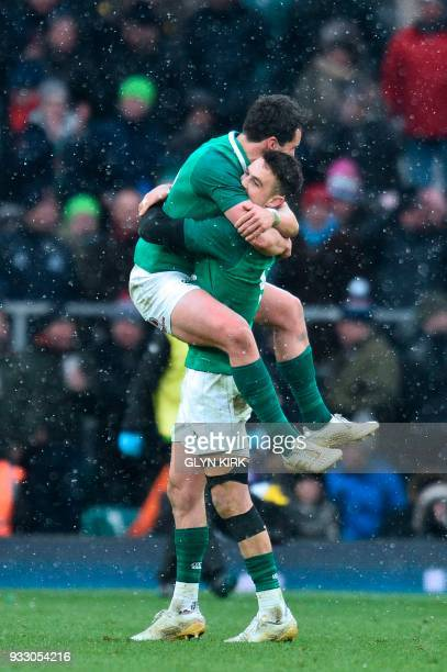 Ireland's scrumhalf Conor Murray and Ireland's Joey Carbery celebrate their victory at the end of their Six Nations international rugby union match...