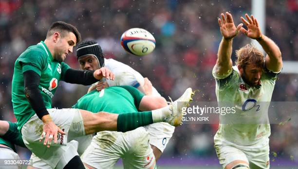TOPSHOT Ireland's scrumhalf Conor Murray clears as England's flanker Chris Robshaw tries to block during the Six Nations international rugby union...