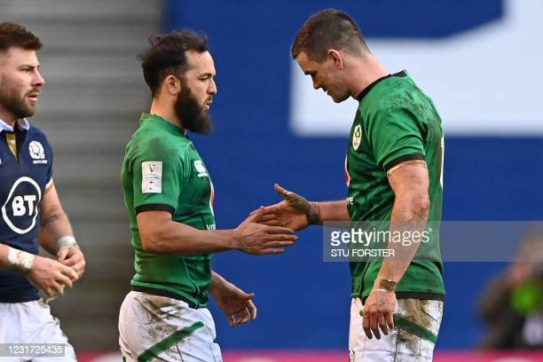 Ireland's scrum-half Jamison Gibson-Park and Ireland's fly-half Johnny Sexton shake hands on the pitch after during the Six Nations international...