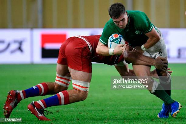 Ireland's scrum-half Luke McGrath is tackled during the Japan 2019 Rugby World Cup Pool A match between Ireland and Russia at the Kobe Misaki Stadium...