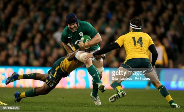 Ireland's Sean O'Brien is tackled by Australia's Tevita Kuridrani and Adam Ashley Cooper during the Guinness Series match at the Aviva Stadium Dublin...