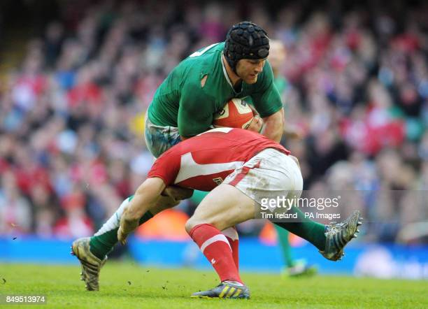 Ireland's Sean O'Brien is tackled by Wales' Leigh Halfpenny during the RBS 6 Nations match at the Millennium Stadium Cardiff