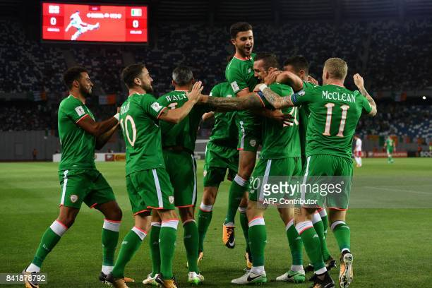 Ireland's Shane Duffy and his teammates celebrates scoring a goal during the 2018 FIFA World Cup group D qualifying football match between Georgia...