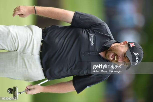Ireland's Shane Lowry celebrates on day four of the BMW PGA Championships at the Wentworth Club Surrey