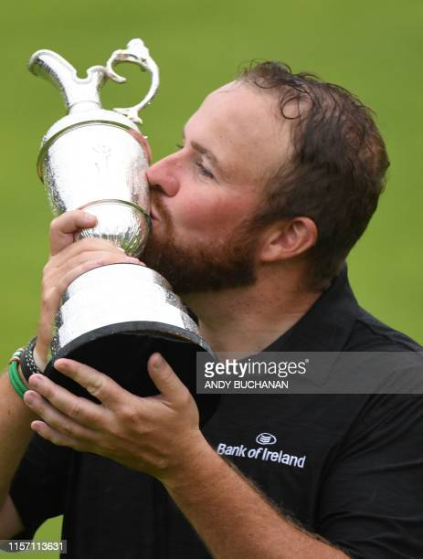 Ireland's Shane Lowry kisses the Claret Jug the trophy for the Champion golfer of the year after winning the British Open golf Championships at Royal...