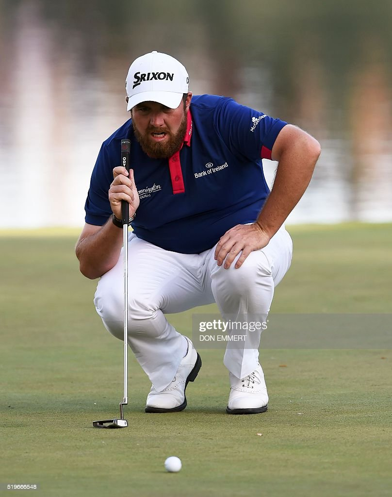 Ireland's Shane Lowry lines up a putt on the 16th green during Round 1 of the 80th Masters Golf Tournament at the Augusta National Golf Club on April 7, 2016, in Augusta, Georgia. EMMERT