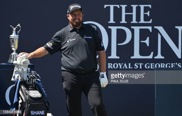 Ireland's Shane Lowry, reigning Open champion, stands next to the Claret Jug trophy on the 1st tee during his final round on day 4 of The 149th...