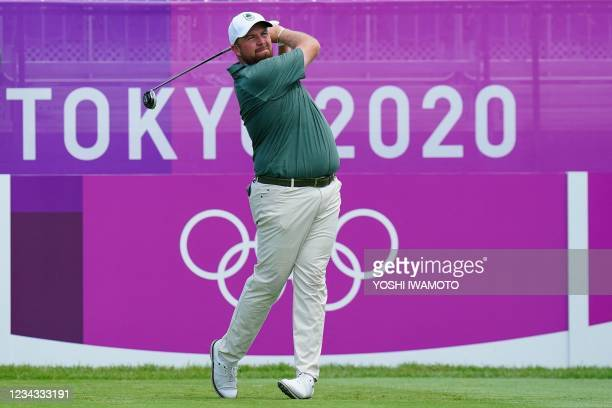 Ireland's Shane Lowry watches his drive from the 1st tee in round 3 of the mens golf individual stroke play during the Tokyo 2020 Olympic Games at...