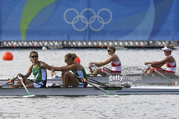 Ireland's Sinead Lynch is congratulated by Ireland's Claire Lambe beside Canada's Lindsay Jennerich and Canada's Patricia Obee during the LWT Women's...