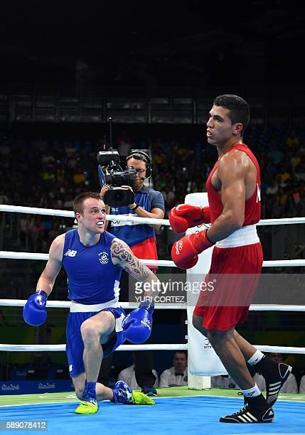 Ireland's Steven Gerard Donnelly stands up after being knocked down by Morocco's Mohammed Rabii during the Men's Welter Quarterfinal 1 at the Rio...