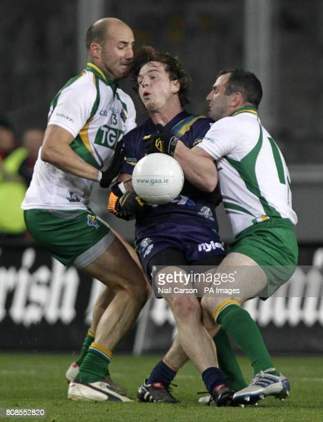 Ireland's Steven McDonnell and Tadhg Kennelly tackle Australia's Liam Picken during the Irish Daily Mail International Rules Series match at Croke...