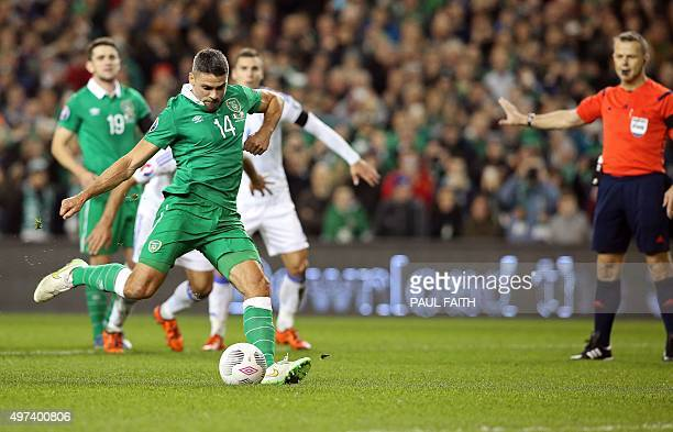 Ireland's striker Jonathan Walters shoots to score his team's first goal from a penalty during a UEFA Euro 2016 Group D qualifying second leg playoff...