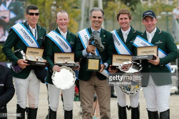 Ireland's team celebrate on the podium after winning the Longines FEI Jumping Nations Cup Final at the Olympic arena of the Real Club de Polo of...