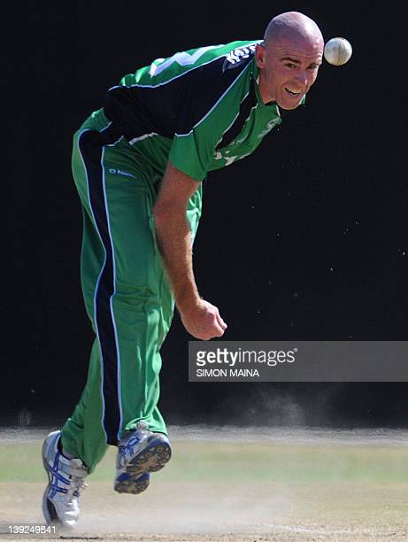 Ireland's Trent Johnson bowls against Kenya on February 18 2012 during the first of twooneday internationals at the Mombasa sports club in MobassaThe...