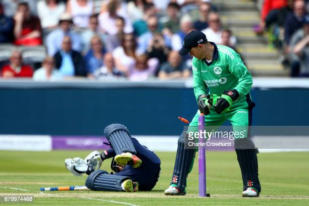 Ireland's wicket keeper Niall O'Brien looks on at England's Adil Rashid as he rolls over the crease during the Royal London ODI between England and...