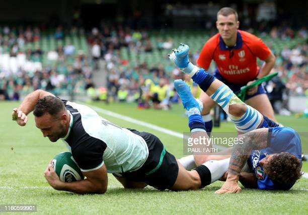TOPSHOT Ireland's wing Dave Kearney scores the team's second try past Italy's Matteo Minozzi during the 2019 Rugby World Cup warmup rugby union match...