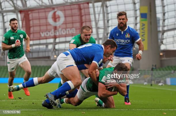 Ireland's wing Hugo Keenan dives to score his team's second try during the Six Nations international rugby union match between Ireland and Italy at...