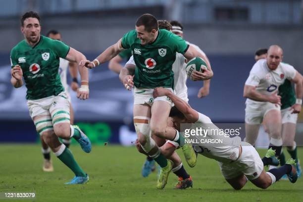 Ireland's wing Jacob Stockdale is tackled by England's scrum-half Ben Youngs during the Six Nations international rugby union match between Ireland...