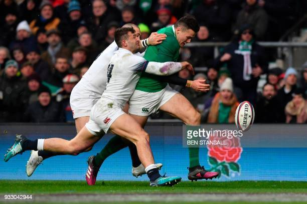 Ireland's wing Jacob Stockdale runs onto the ball to score their third try during the Six Nations international rugby union match between England and...