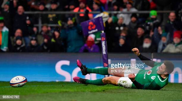 Ireland's wing Jacob Stockdale scores their third try during the Six Nations international rugby union match between England and Ireland at the...