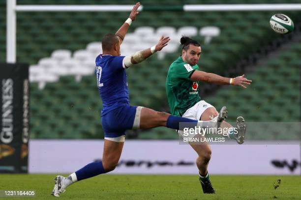 Ireland's wing James Lowe kicks the ball under pressure from France's centre Gael Fickou during the Six Nations international rugby union match...
