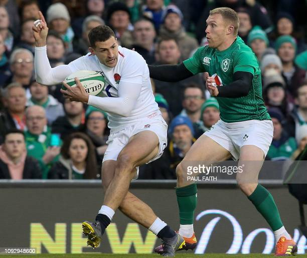 Ireland's wing Keith Earls closes in England's wing Jonny May during the Six Nations international rugby union match between Ireland and England at...