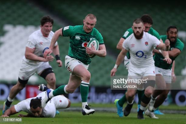 Ireland's wing Keith Earls gets past England's number 8 Billy Vunipola on his way to his team's first try during the Six Nations international rugby...