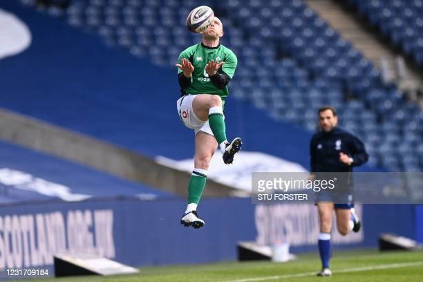 Ireland's wing Keith Earls warms up ahead of the Six Nations international rugby union match between Scotland and Ireland at Murrayfield Stadium in...